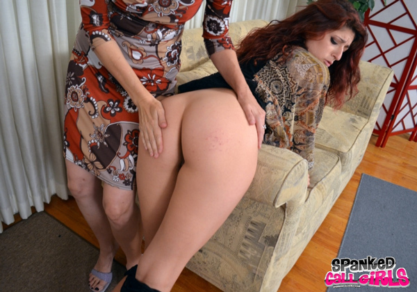 Clare spanks Nikki Knightly's big bottom over the arm of the couch