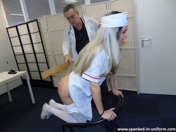 The naughty nurse braces herself for the leather strap