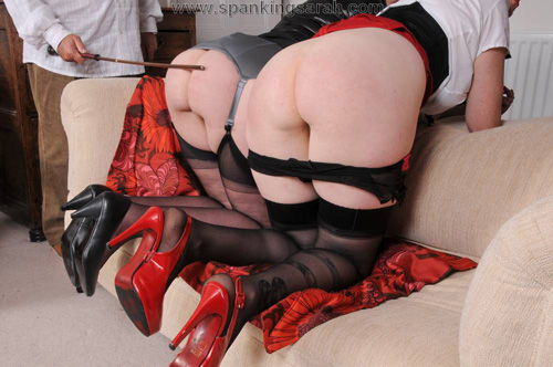 The naughty British ladies get caned side-by-side on bare bottoms