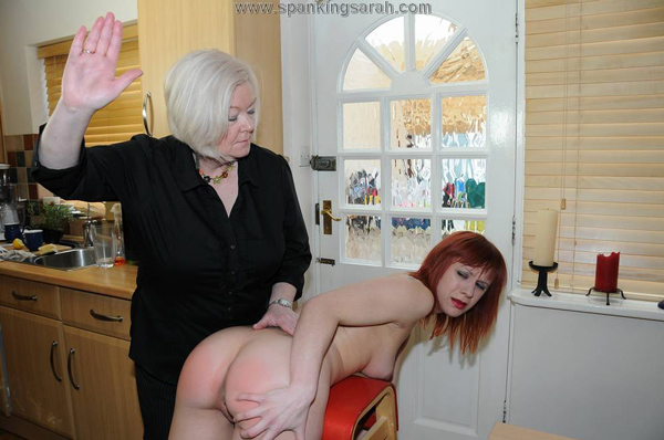 Darcy Grey gets spanked naked over the punishment stool