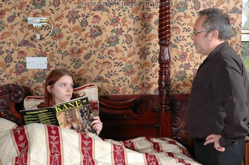 Kami Robertson gets caught sitting in bed reading Kane magazine