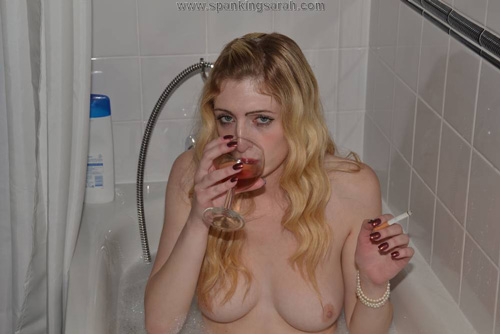 Porn model Jessica Jensen relaxes with cigarette and a glass of wine in the bath