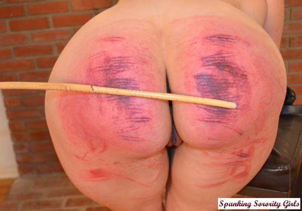 The severe punishment continues and the cane makes Ashley's big bottom very marked indeed