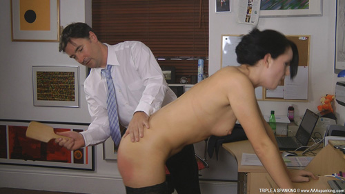 Stripped down to her stockings and bending over the desk Jasmine gets spanked