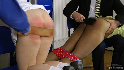 Danielle gets an OTK hairbrush spanking and Kami bends over for the strap