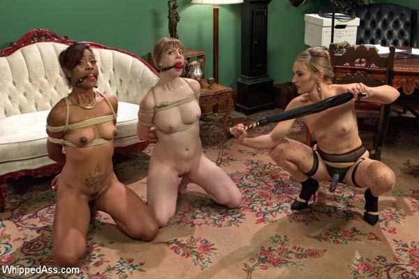 Lotus Lain and Dolly Leigh get their titties whipped with the flogger