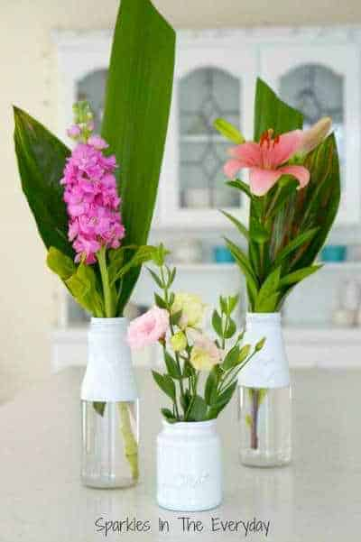 flower and recycled bottles for beautiful vases - Top 10 Craft and Recipe Ideas For 2015 from Sparkles In The Everyday!