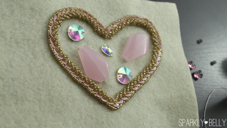 Sew on large stones on heart applique