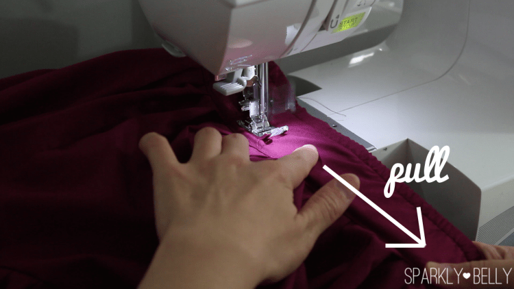 Pull elastic waistband while sewing