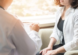 doctor speaking with female patient