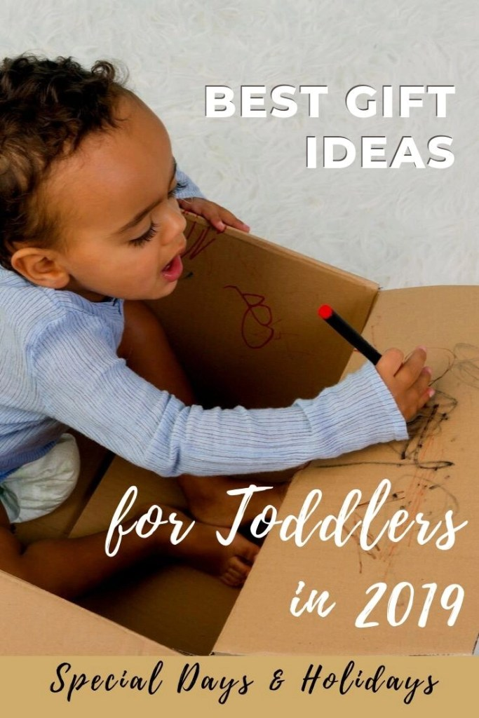 Best Toddler Gifts pin of boy inside big cardboard box drawing on it