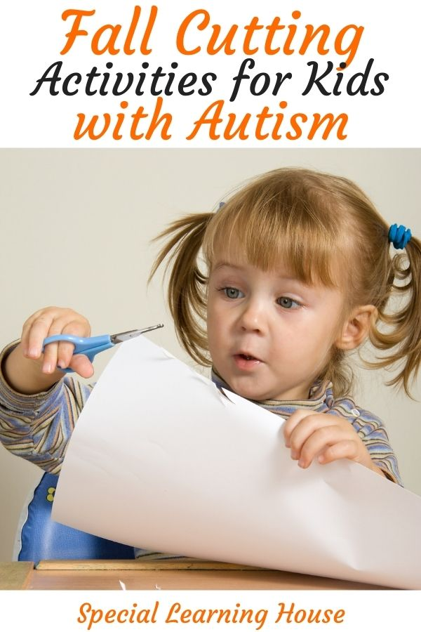 Fall cutting activities for kids with autism - little girl cutting paper using blue scissors