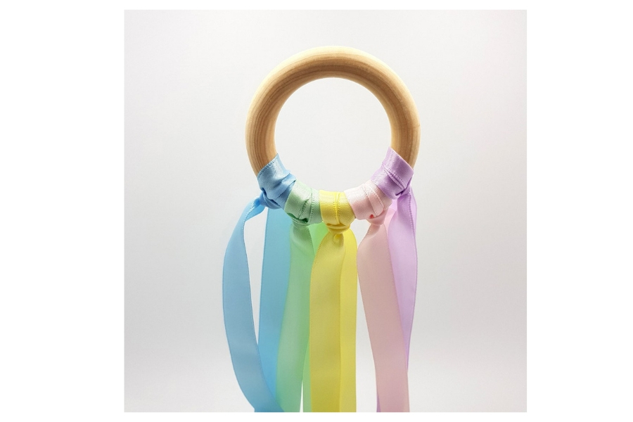 rainbow ribbon on a wooden ring