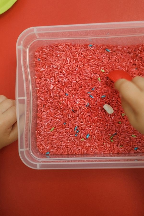 red dried rice sensory bin for kids with autism