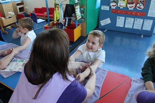 child being massaged in school setting