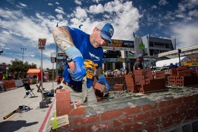 Zac Guire swiping mud onto a brick
