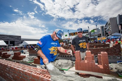 Emilio Dibra spreading SPEC MIX mortar on his wall at the 2021 SPEC MIX BRICKLAYER 500