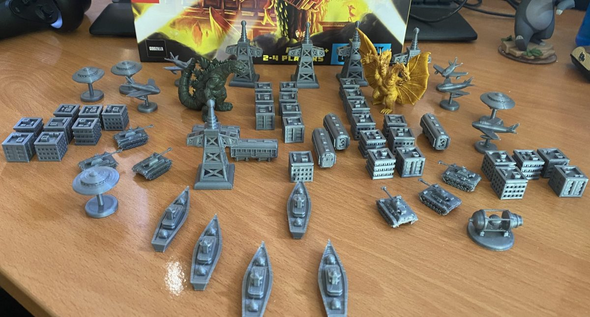 An assortment of custom-made tokens for the board game Godzilla: Tokyo Clash