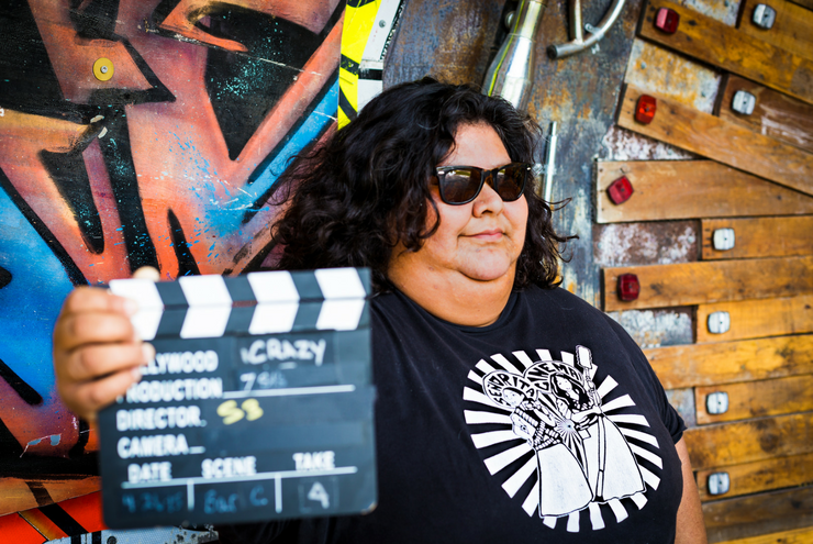 A photo of Latina filmmaker and Señorita Cinema creator Stephanie Saint Sanchez, founder of Senorita Cinema in Smithers Park in Houston, Texas.