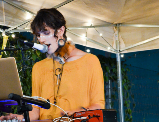 A photo of The Artemis Glow performing at the Gender Unbound Art Fest in Austin, Texas
