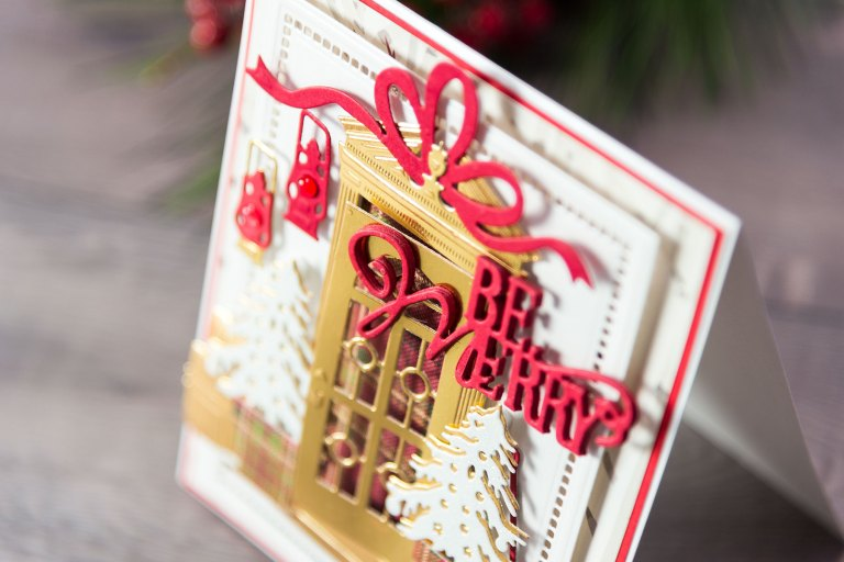 Be Merry Christmas Card by Yana Smakula for Spellbinders. Using: S2-090 Edwardian Door, S2-241 Green Thumb, S3-244 Shoreline, S3-255 Canoeing, S3-269 Naughty or Nice, S3-271 Holiday Bell, S3-275 Camping, S4-823 Presents, S5-308 Hemstitch Rectangles #spellbinders #cardmaking #diecutting #Christmascard