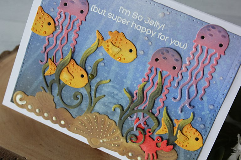 Video Friday | Inking White Die Cuts Ocean Scene Card with Nichol for Spellbinders. Using: S4-671 Sea Life Accents, S3-257 Sea Animals, S4-904 Scored and Pierced Rectangles #spellbinders #diecutting #handmadecard #neverstopmaking