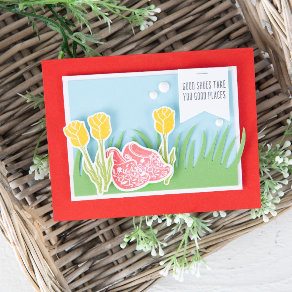 Good Shoes Take You Good Places handmade card with Fun Stampers Journey March 2019 Stamp of the Month, called Good Places. The wooden clogs and tulips are darling nested in die cut grass. #funstampersjourney #diecutting