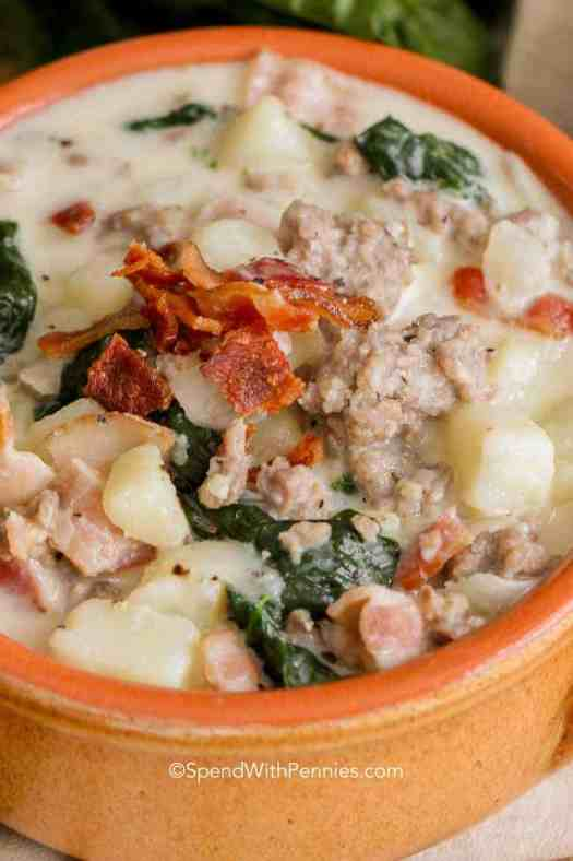Homemade Zuppa Toscana served in a terra cotta bowl