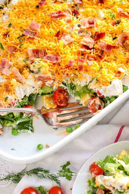 Serving 7 Layer Salad out of a 9x13 pan - a simple and quick potluck dish!