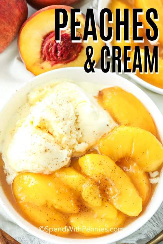 Peaches in a white bowl with cinnamon sprinkle and ice cream