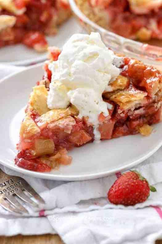 Fresh strawberry rhubarb pie with cold vanilla ice cream.