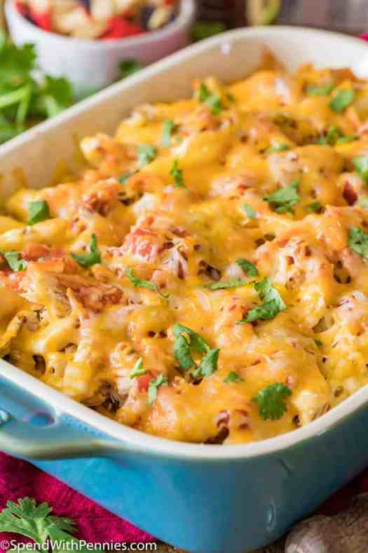 Cheesy chicken casserole topped with melted cheddar cheese and fresh cilantro.
