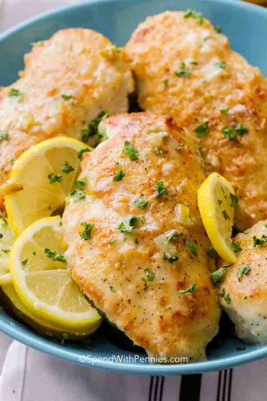 Lemon Pepper Chicken served in a bowl with lemon slices and parsley for garnish - the perfect dinner dish!