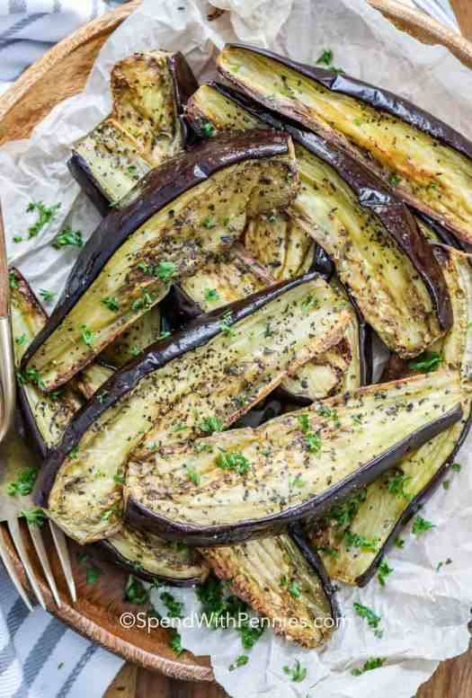 overview of roasted eggplant on a serving dish garnished with parsley.