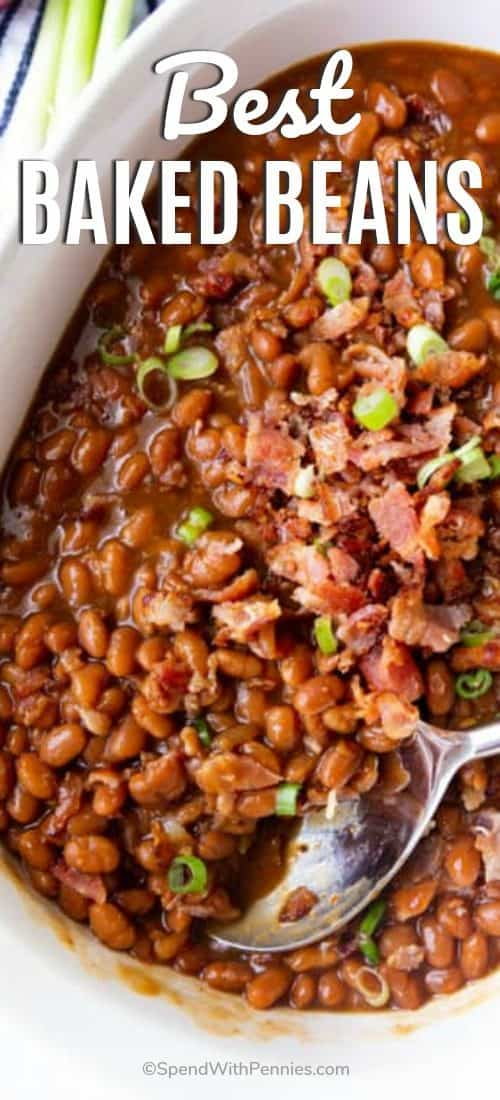 Baked Beans in a white dish and served with a spoon