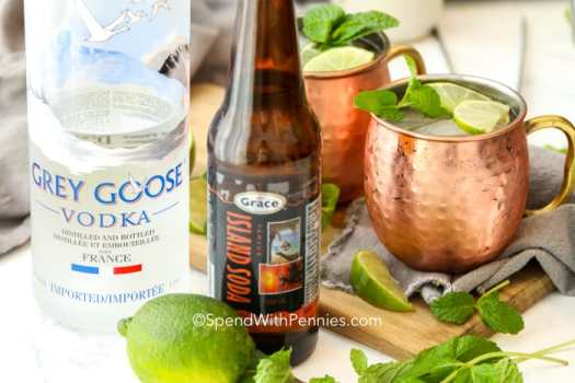 Moscow Mule ingredients with lime and mint garnish.