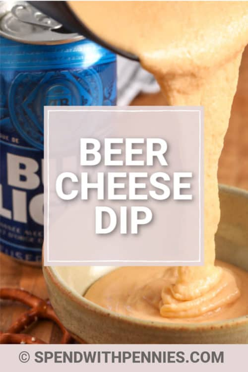 Warm beer cheese dip being poured into a bowl.