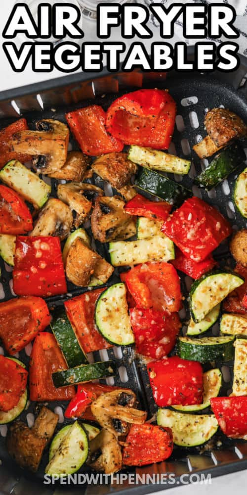 Air Fryer Vegetables in the air fryer cooked with writing