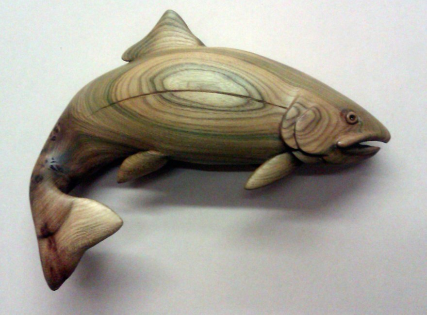 Carved wooden wall-mounted trout