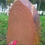 Hand-carved headstone memorial sandstone with pike motif, Gordonstoun School