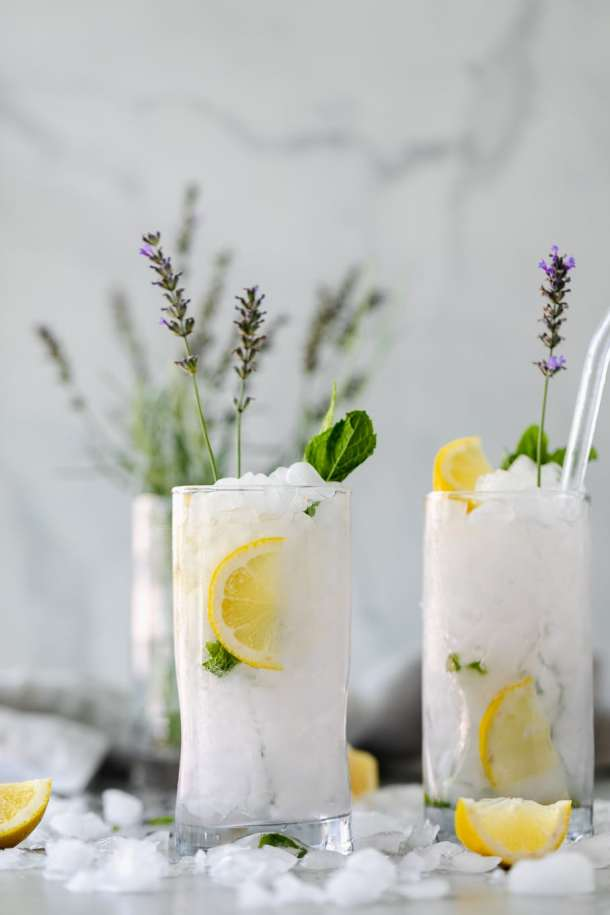 Forward facing shot of 2 lavender mint vodka lemonades