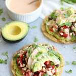 Smashed Avocado, Black Bean, and Corn Tostadas with Chipotle Crema