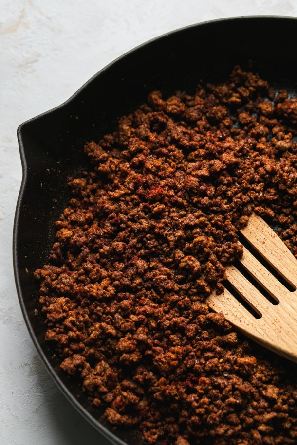 Shot of ground taco beef in a cast iron skillet