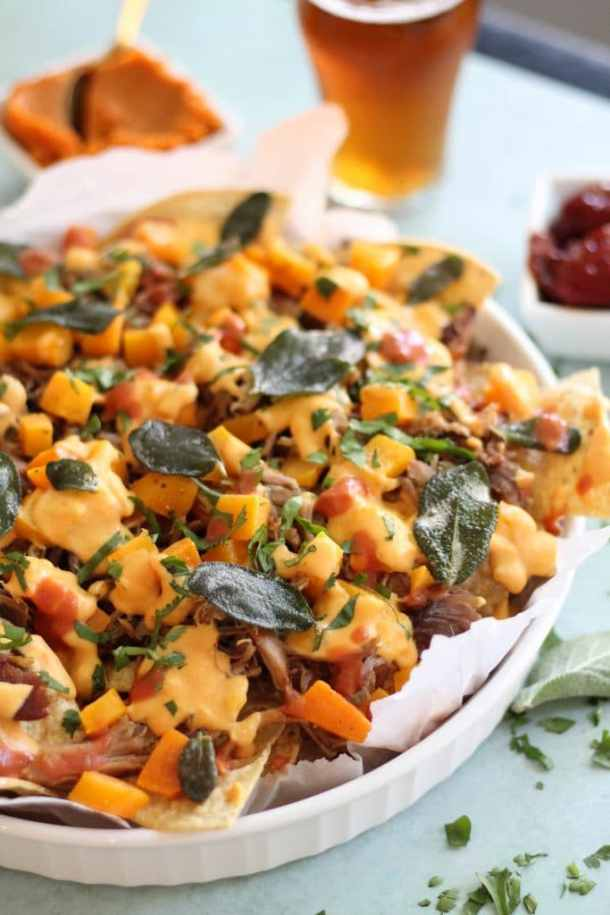 Pulled Pork Nachos with Pumpkin Chipotle Queso, Butternut Squash, and Crispy Sage