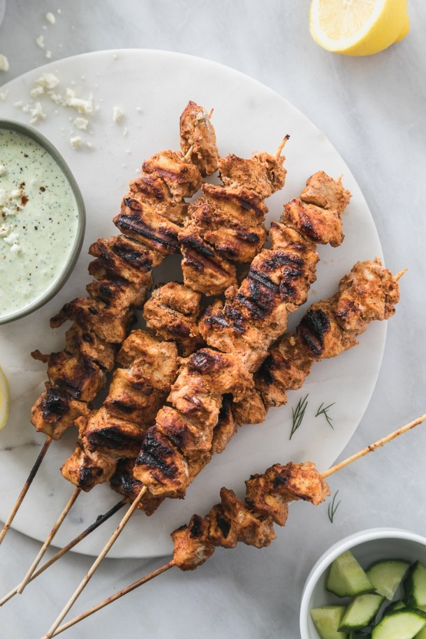Overhead shot of a pile of grilled chicken skewers