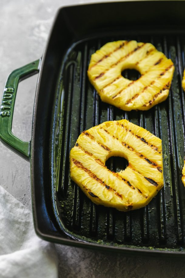 Close up shot of grilled pineapple rings on a grill pan