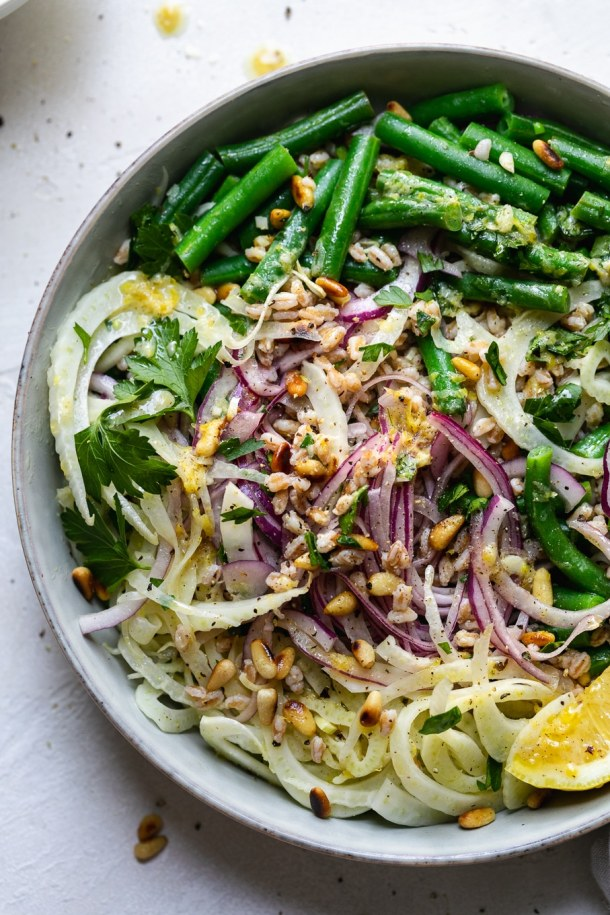 Overhead close up shot of a colorful green bean salad