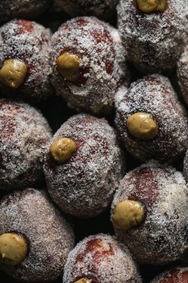 Super close up shot of dirty chai cream filled doughnuts