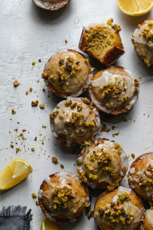 Overhead shot of lemon pistachio muffins arranged in a line