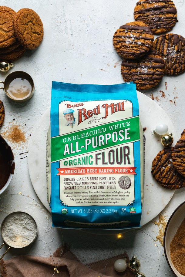 Overhead shot of a bag of flour surrounded by gingersnaps